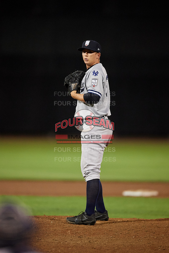 Staten Island Yankees relief pitcher Keegan Curtis (33) gets ready to deliver a pitch during a game against the Aberdeen IronBirds on August 23, 2018 at Leidos Field at Ripken Stadium in Aberdeen, Maryland.  Aberdeen defeated Staten Island 6-2.  (Mike Janes/Four Seam Images)