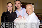 Hedvika and Timothy O'Connor who had their baby son Oisin christened in the Church of the Assumption, Mountcollins on Sunday afternoon, pictured also is Fr. William O'Gorman.