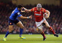 Jonathan Davies of Wales (R) pushes away Maxime Machenaud of France (L) during the Wales v France, 2016 RBS 6 Nations Championship, at the Principality Stadium, Cardiff, Wales, UK