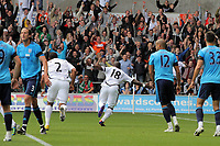 Pictured: Leroy Lita of Swansea (C) celebrating his goal to the delight of supporters in the background. Saturday 17 September 2011<br /> Re: Premiership football Swansea City FC v West Bromwich Albion at the Liberty Stadium, south Wales.