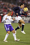 10 February 2006: Landon Donovan (10), of the U.S., beats Japan's Shinji Ono (18) to the ball. The United States Men's National Team defeated Japan 3-2 at SBC Park in San Francisco, California in an International Friendly soccer match.
