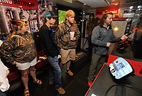 NWA Democrat-Gazette/ANDY SHUPE<br /> Scott Callaway (right) of Be Pro, Be Proud shows diagnostic equipment used by electricians and HVAC technicians Wednesday, May 32, 2017, to a group of students from Huntsville High School in the organization's trailer outside Northwest Technical Institute in Springdale. Schools from Huntsville, Har-Ber and Elkins came to the school to tour the facility and meet with representatives from Be Pro, Be Proud which promotes technical education options to high school students.