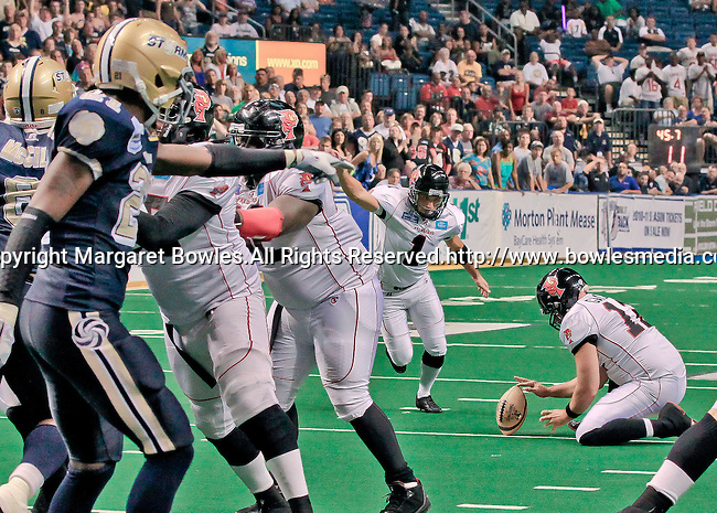 Aug 14, 2010: Orlando Predator placekicker Carlos Martinez (#1) attempts a field goal against the Tampa Bay Storm.  The Storm defeated the Predators 63-62 to win the division title at the St. Petersburg Times Forum in Tampa, Florida. (Mandatory Credit:  Margaret Bowles)