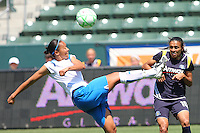 Kristine Lilly #16 of the Boston Breakers controls the ball past Marta #10 of the Los Angeles Sol during their WPS match at Home Depot Center on May 10, 2009 in Carson, California.