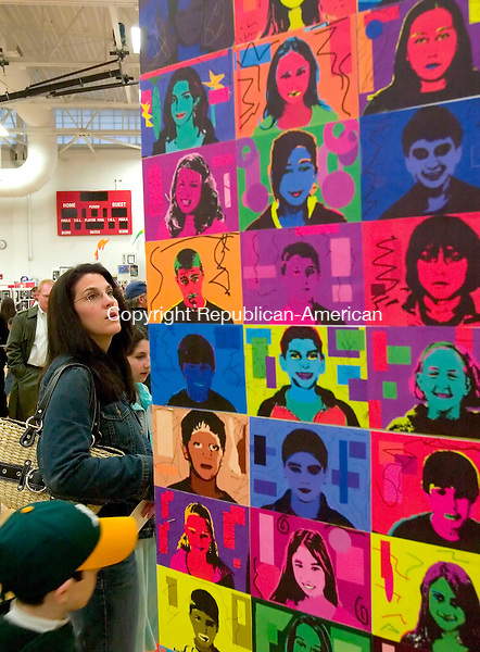 SOUTHBURY, CT--27 APRIL 2007--042707JS11-Dawn Shapiro of Southbury, along with her childern Carly Shapiro, 12 and Max Shapiro, 9,  looks over some of the artwork on display during the Regional 15 School District's 19th annual Gallery Opening of Selected Student Artwork Friday at Pomperaug High School in Southbury. <br /> Jim Shannon / Republican-American
