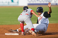Jose Martinez (40) of the Kannapolis Intimidators is tagged out while attempting to steal second base versus the Lakewood BlueClaws at Fieldcrest Cannon Stadium in Kannapolis, NC, Sunday, May 11, 2008.