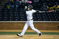 Jonathan Pryor (11) of the Wake Forest Demon Deacons follows through on his swing against the Kent State Golden Flashes in game two of a double-header at David F. Couch Ballpark on March 4, 2017 in Winston-Salem, North Carolina.  The Demon Deacons defeated the Golden Flashes 5-0.  (Brian Westerholt/Four Seam Images)