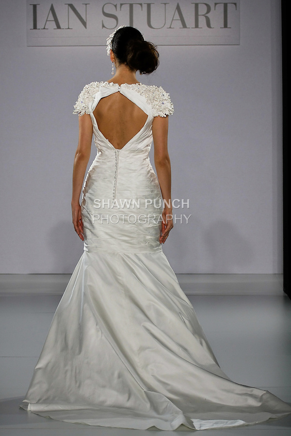 Model walks runway in a Sunset Boulevard wedding dress from the Ian Stuart - Supernova Bridal Collection 2013 fashion show, at the Couture Show during New York Bridal Fashion Week, October 14, 2012.
