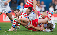 Picture by Allan McKenzie/SWpix.com - 17/04/2015 - Rugby League - Ladbrokes Challenge Cup - Wakefield Trinity Wildcats v Halifax RLFC - Rapid Solicitors Stadium, Wakefield, England - Halifax's Mitch Calhane is dragged down by Wakefield's Daniel Smith.