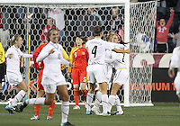 Alex Morgan #21 of the USA WNT is congratulated by Yael Averbuch #4 after scoring the tying goal during an international friendly match against the PRC WNT at PPL Park, on October 6 2010 in Chester, PA. The game ended in a 1-1 tie.