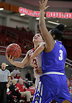 VERMILLION, SD: JANUARY 13:  Madison McKeever #23 of South Dakota tries to get past Ft. Wayne defender KeShyra McCarver #3 during their Summit League game Saturday January 13 at the Sanford Coyote Sports Center in Vermillion, S.D.   (Photo by Dick Carlson/Inertia)