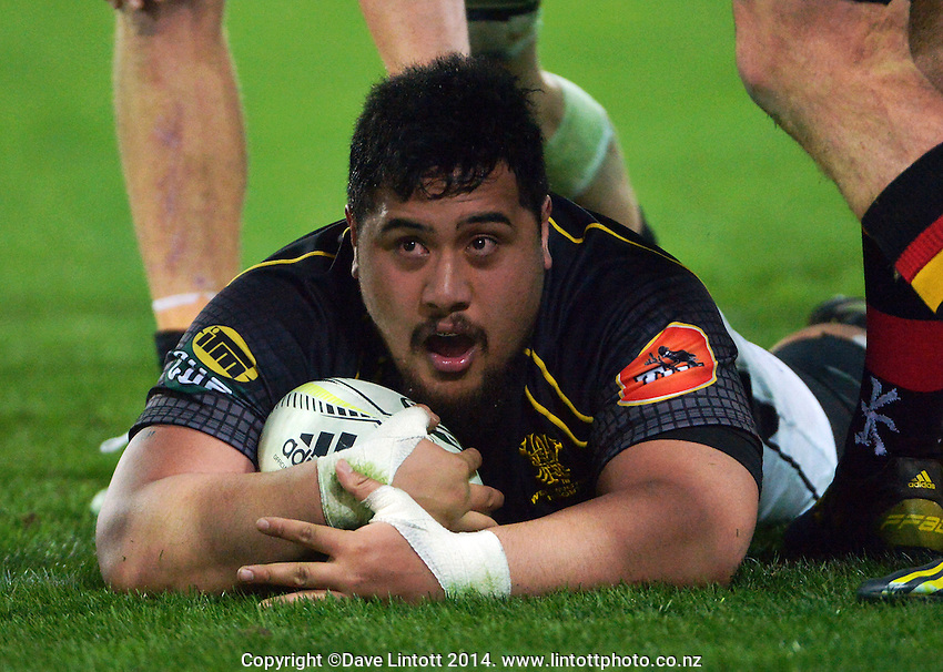Eric Sione looks at the big screen after scoring following a double movement during the ITM Cup rugby union match between Wellington Lions and Waikato at Westpac Stadium, Wellington, New Zealand on Saturday, 16 August 2014. Photo: Dave Lintott / lintottphoto.co.nz