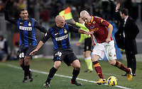 Calcio, semifinale di andata di Coppa Italia: Roma vs Inter. Roma, stadio Olimpico, 23 gennaio 2013..AS Roma midfielder Michael Bradley, of the United States, right, is challenged by FC Inter midfielder Esteban Cambiasso, of Argentina, during the Italy Cup football semifinal first half match between AS Roma and FC Inter at Rome's Olympic stadium, 23 January 2013..UPDATE IMAGES PRESS/Riccardo De Luca