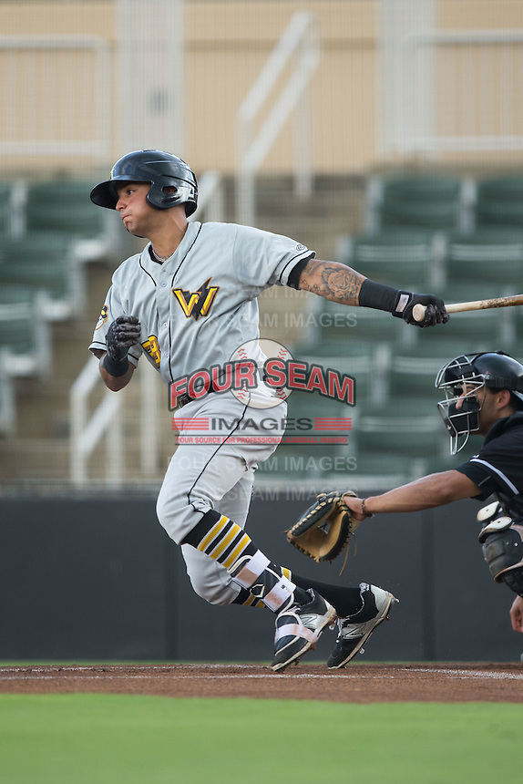 West Virginia Power shortstop Stephen Alemais (38) follows through on his swing against the Kannapolis Intimidators at Kannapolis Intimidators Stadium on August 21, 2016 in Kannapolis, North Carolina.  The game was suspended due to wet grounds with the score tied 1-1.  (Brian Westerholt/Four Seam Images)