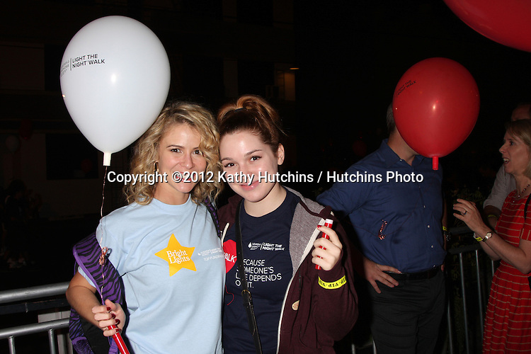 LOS ANGELES - OCT 6:  Linsey Godfrey, Jennifer Stone attends the Light The Night Walk to benefit The Leukemia & Lymphoma Society at Sunset Gower Studios on October 6, 2012 in Los Angeles, CA