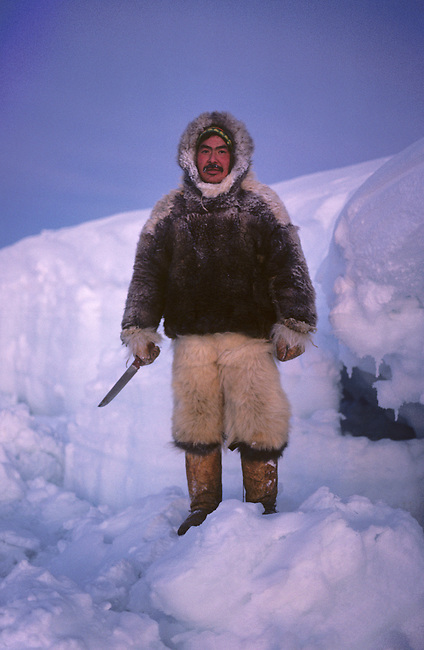 Fur clad Inuit hunter, Ituko Christiansen, wearing polar bear pants..Northwest Greenland.