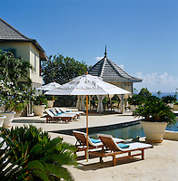 Sun-loungers and the gazebo are positioned to overlook the swimming pool and the ocean beyond