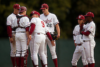 STANFORD, CA - March 25, 2011: Coach Mark Marquess of Stanford baseball talks to the infield during a mound visit during Stanford's game against Long Beach State at Sunken Diamond. Stanford lost 6-3.
