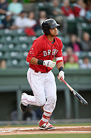 First baseman Pedro Castellanos (24) of the Greenville Drive bats in a game against the Charleston RiverDogs on Friday, April 27, 2018, at Fluor Field at the West End in Greenville, South Carolina. Greenville won, 5-4. (Tom Priddy/Four Seam Images)