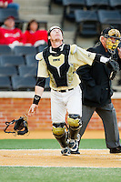 Wake Forest Demon Deacons catcher Brett Armour (6) tracks a pop fly during the game against the North Carolina State Wolfpack at Wake Forest Baseball Park on March 15, 2013 in Winston-Salem, North Carolina.  The Wolfpack defeated the Demon Deacons 12-6.  (Brian Westerholt/Four Seam Images)