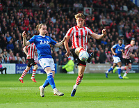 Lincoln City's Mark O'Hara vies for possession with Macclesfield Town's Ben Stephens<br /> <br /> Photographer Andrew Vaughan/CameraSport<br /> <br /> The EFL Sky Bet League Two - Lincoln City v Macclesfield Town - Saturday 30th March 2019 - Sincil Bank - Lincoln<br /> <br /> World Copyright © 2019 CameraSport. All rights reserved. 43 Linden Ave. Countesthorpe. Leicester. England. LE8 5PG - Tel: +44 (0) 116 277 4147 - admin@camerasport.com - www.camerasport.com