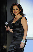 """Washington, DC - October 13, 2009 -- Gloria Estefan walks on to the stage to perform at a White House Music Series """"Fiesta Latina"""" with United States President Barack Obama on the South Lawn of the White House in Washington on October 13, 2009..Credit: Alexis C. Glenn / Pool via CNP"""
