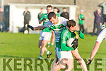 Cathal Kearney Ballyduff attacking on goal despite the attention of Jim Cremin Ballydonoghue in Ballybunion on Sunday at the North Kerry Championship Semi Final.