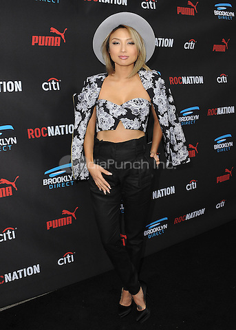 BEVERLY HILLS, CA - FEBRUARY 7:  Jeannie Mai at the 5th Annual Roc Nation Pre-Grammy Brunch at Roc Nation offices on February 7, 2015 in Beverly Hills, California. SKPG/Mediapunch