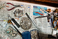 The jeweler's working tools are seen in the jewelry workshop in Bogota, Colombia, 8 February 2014. Around 60% of the world's emerald production come from Colombia. Most of the gemstones are cut, faceted and processed into jewelry in the workshops located in the emerald district in downtown Bogota. There are approximately 2000 jewelers working in the emerald district. Due to their special clarity and deep vivid green color, Colombian emeralds are considered the most beautiful in the world.
