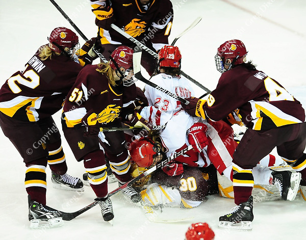Hilary Knight (23) gets caught in a melee, as the Wisconsin women's hockey team tops Minnesota-Duluth 2-1 to advance to the Frozen Four on Saturday, 3/12/11, at the Kohl Center in Madison, Wisconsin