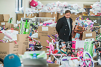 STAFF PHOTO ANTHONY REYES &bull; @NWATONYR<br /> Danny Camarillo, with the Salvation Army, tours a storage facility Tuesday, Dec. 16, 2014 for the Salvation Army's toys in Springdale. Gifts from the Salvation Army's Angel Tree program are organized and stored at the facility. The organization will be handing the gifts out over the next few days along with food items donated by local organizations including a turkey and eggs.