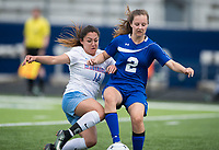 NWA Democrat-Gazette/CHARLIE KAIJO Southside High School midfielder Dianna Guerrero (14) and Rogers High School Ellison Verser (2) fight for possession of the ball during the semifinals of the 7A Girls State Soccer Tournament, Saturday, May 12, 2018 at Whitey Smith Stadium at Rogers High School in Rogers. Rogers advanced to the finals when midfielder Skylurr Patrick (3) scored both of Rogers' goals defeating Southside High School, 2-1.