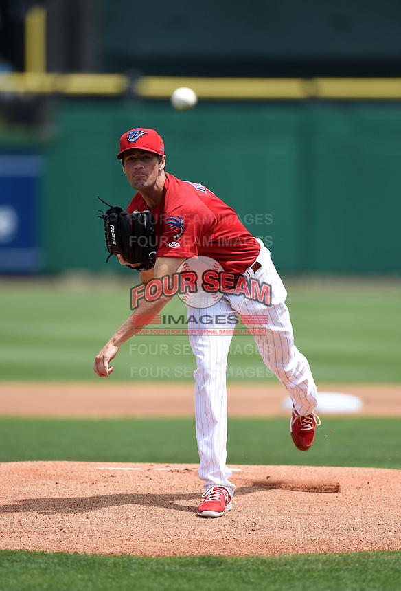 Philadelphia Phillies pitcher Cole Hamels delivers a warmup pitch while on rehab assignment with the Clearwater Threshers during a game against the Dunedin Blue Jays on April 6, 2014 at Bright House Field in Clearwater, Florida.  Hamels went a scheduled four innings allowing three hits and striking out four taking the loss as Dunedin defeated Clearwater by the score of 5-2.  (Mike Janes/Four Seam Images)