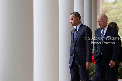United States President Barack Obama  and U.S. Vice President Joe Biden emerge from the Oval Office to deliver a statement after gun legislation failed in Congress, in the Rose Garden at the White House, in Washington, Wednesday, April 17, 2013. The president was accompanied by Vice President Joe Biden, former U.S. Representative Gabby Giffords (Democrat of Arizona) and family members from Newtown..Credit: Drew Angerer / Pool via CNP