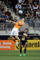 Cam Weaver (15) of the Houston Dynamo heads the ball over Sheanon Williams (25) of the Philadelphia Union. The Philadelphia Union and the Houston Dynamo played to a 1-1 tie during a Major League Soccer (MLS) match at PPL Park in Chester, PA, on August 6, 2011.
