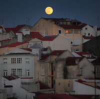 Houses in the moonlight in the old town of Lisbon, Portugal. Most of the buildings in this district date to the 17th century. Picture by Manuel Cohen