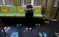 MEDELLÍN, COLOMBIA-MAY 4:  A woman wears face masks and sits in designated seats in a subway car as a preventive measure against the spread of the new coronavirus COVID-19, in Medellín, Colombia, on May 4, 2020. The distance physical and the maximum occupation of 35% of the public transport system, a requirement of the National Government, as a preventive measure to stop the spread of COVID-19 (Photo by Fredy Builes/VIEWpress)