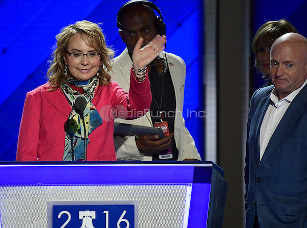 Former United States Representative Gabby Giffords (Democrat of Arizona) waves as she rehearses her remarks prior to the opening session of the 2016 Democratic National Convention at the Wells Fargo Center in Philadelphia, Pennsylvania on Monday, July 25, 2016.  Her husband former astronaut Mark Kelly look on from right.<br /> Credit: Ron Sachs / CNP/MediaPunch<br /> (RESTRICTION: NO New York or New Jersey Newspapers or newspapers within a 75 mile radius of New York City)