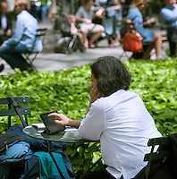 A visitor to Bryant Park in New York uses her tablet computer on Friday, May 10, 2013.  (© Richard B. Levine)