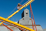 Metal covered grain elevator, colorful yellow and red grain augers