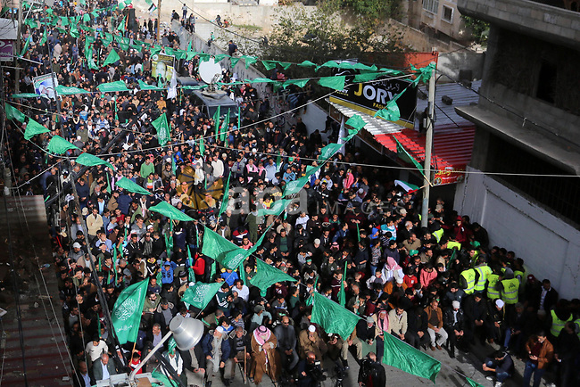 Palestinian Hamas supporters gather to attend a Hamas rally marking the 32th anniversary of the Islamist movement's founding in Khan Younis in the southern of Gaza strip, on December 13, 2019. Photo by Ashraf Amra