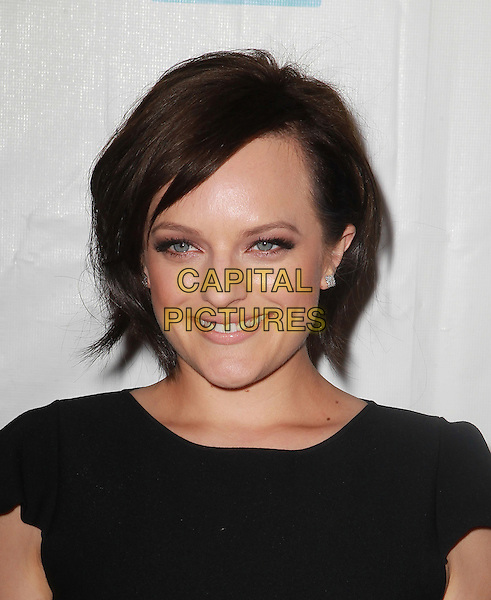 Elisabeth Moss.41st Annual Peace Over Violence Humanitarian Awards Held At The Beverly Hills Hotel, Beverly Hills, California, USA, 26th October 2012..portrait headshot smiling  black .CAP/ADM/KB.©Kevan Brooks/AdMedia/Capital Pictures.