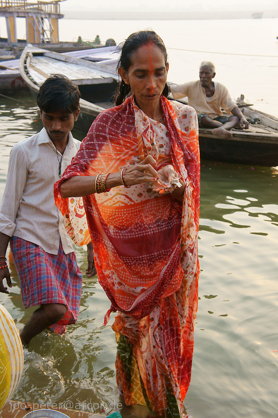 in this ceremony women gather at the river and pray for sons and good luck of her family (a woman without a son is belived to end up in hell, also a widow is believed to be cursed and can be expelled by the family).