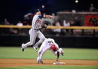 Jun. 7, 2010; Phoenix, AZ, USA; Atlanta Braves second baseman Martin Prado throws to first base after forcing out Arizona Diamondbacks baserunner Justin Upton in the first inning at Chase Field. Mandatory Credit: Mark J. Rebilas-