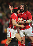 Adam Jones celebrates with Leigh Halfpenny after the wing scores for Wales..RBS 6 Nations 2012.Wales v Scotland.Millennium Stadium.12.02.12.Credit: Steve Pope - Sportingwales