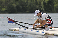 Banyoles, SPAIN,  USA LM1X checks his attaches his watch and speed coach/Rate meter before a training session at the FISA World Cup Rd 1. Lake Banyoles  Thursday 28/05/2009   [Mandatory Credit. Peter Spurrier/Intersport Images]