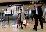 Passengers walk past the arrivals board at Sendai airport in Natori, Miyagi Prefecture, Japan on 14 April, 2011. .Photographer: Robert Gilhooly