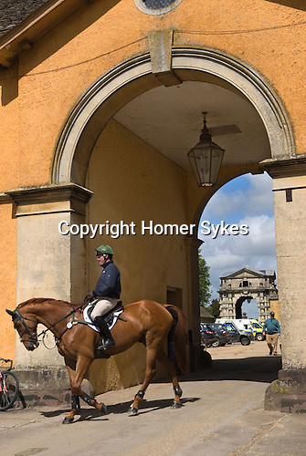 Badminton Horse Trials Gloucestershire UK. A competitor makes his way back to the stables Badminton House.