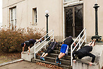 December 22, 2014. Lexington, North Carolina.<br />  Mayor Newell Clark, left, and other participants in his workout routine, do pushups on the steps of a local art gallery. <br />   Newell Clark, the 43 year old mayor of Lexington, NC, leads a group of friends and colleagues on a 4 times a week exercise routine around downtown. The group uses existing infrastructure, such as an abandoned furniture factory, loading docks, stairs, and handrails to get fit and increase awareness of healthy lifestyles in a town more known for BBQ.<br /> Jeremy M. Lange for the Wall Street Journal<br /> Workout_Clark