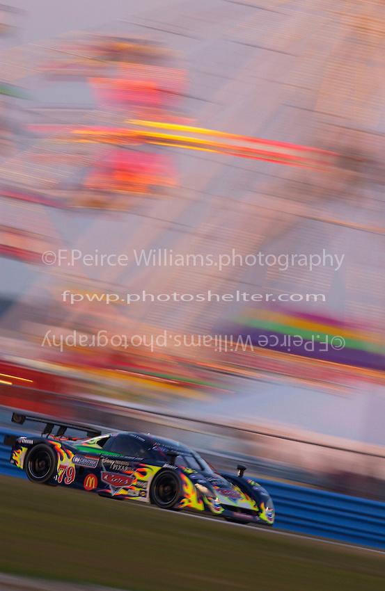 Rolex 24 at Daytona, Daytona International Speedway 5/6 Feb, 2005.P.L.N. drives the #79 Ford/Crawford past the infield's ferris wheel as darkness falls..Copyright©F.Peirce Williams 2005